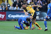 Bayo Akinfenwa of AFC Wimbledon and Leon Legge of Cambridge United tussle during the Sky Bet League 2 match between Cambridge United and AFC Wimbledon at the R Costings Abbey Stadium, Cambridge, England on 2 January 2016. Photo by Stuart Butcher.