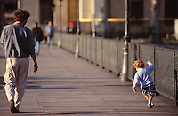 kid walking with his FATHER on the Pont des arts, Paris