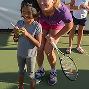 August 19, 2014, New Haven, CT:<br /> Coco Vandeweghe poses for a photograph with a girl during a Girl Scout Night clinic on day five of the 2014 Connecticut Open at the Yale University Tennis Center in New Haven, Connecticut Tuesday, August 19, 2014.<br /> (Photo by Billie Weiss/Connecticut Open)