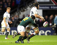 © SPORTZPICS /Seconds Left Images 2010 - Adrian Jacobs  cleverly knocks the ball out of England's Tom Palmer 's hands preventing a good scoring opportunity - England v South Africa  - Investec Challenge Series - 27/11/20110 - Twickenham Stadium  - London - All rights reserved.