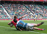 Twickenham, Surrey United Kingdom. Russian, Vladislav SOZONOV, touches down,  despite, Frances, Robinsons CAIRE's tackled., during the Pool B game France vs Russia at the  &quot;2017 HSBC London Rugby Sevens&quot;,  Saturday 20/05/2017 RFU. Twickenham Stadium, England    <br /> <br /> [Mandatory Credit Peter SPURRIER/Intersport Images]
