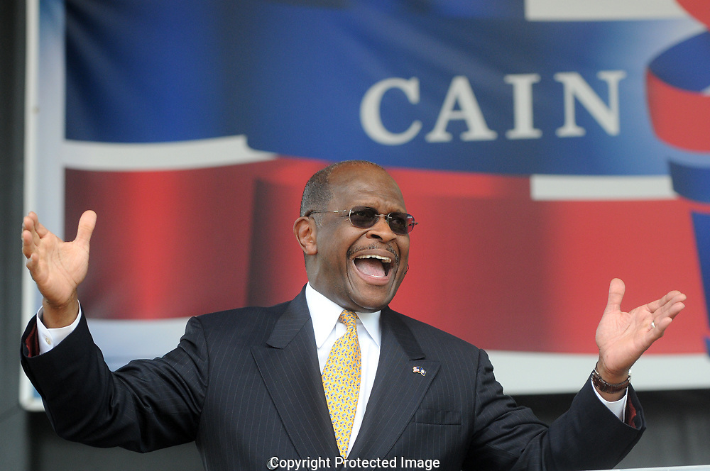 """ATLANTA, GA - May 21, 2011: Herman Cain officially announced today that he's running for the Republican presidential nomination. """"Is America ready for a leader and not a reader?"""" Cain asked the cheering crowd of thousands at Atlanta's Centennial Olympic Park."""