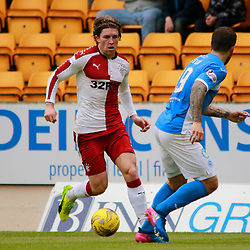 Josh Windass looks for a route past Richard Foster