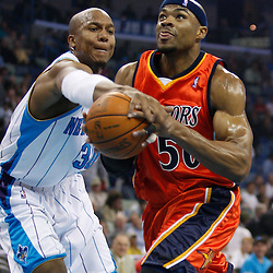 Mar 08, 2010; New Orleans, LA, USA; Golden State Warriors forward Corey Maggette (50) draws a foul from New Orleans Hornets forward David West (30) during the first half at the New Orleans Arena. Mandatory Credit: Derick E. Hingle-US PRESSWIRE