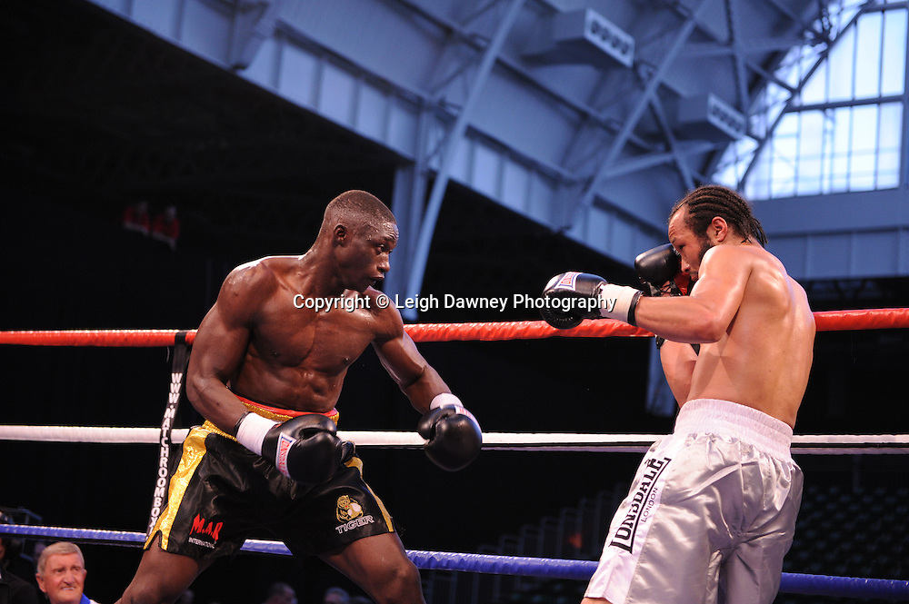 Patrick Mendy (black shorts) defeats Paul Samuels at London's Olympia on Saturday 30th April 2011. Matchroom Sport. Photo credit © Leigh Dawney.