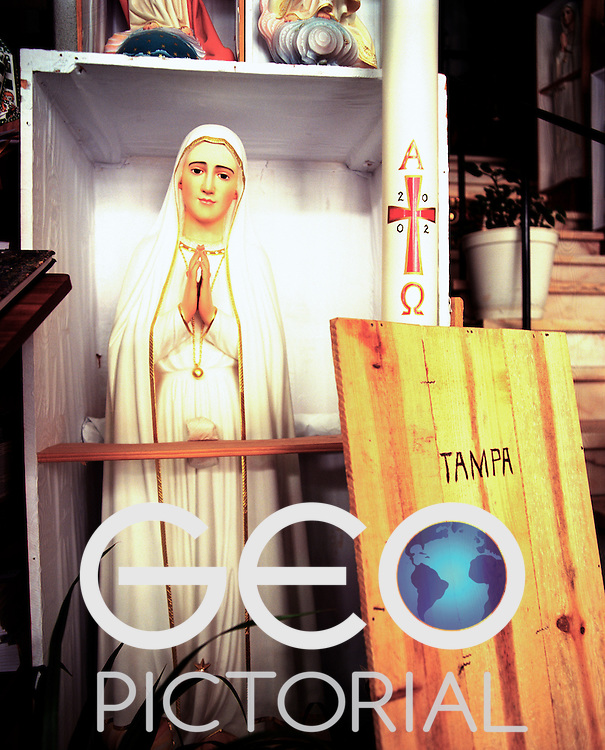 A half size replica statute of the Madonna of Fatima stands in its box in a souvenir shop ready for shipment to a customer in the USA.