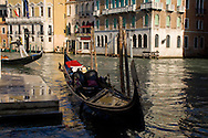 A gondola on the Grand Canal near the Rialto Bridge;  Venice, Italy