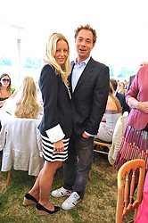 DAN PHILIPSON and ASTRID HARBORD at a charity polo match organised by Jaeger Le Coultre was held at Ham Polo Club, Richmond, Surrey on 12th June 2009.