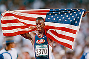 ATLANTA - JULY 30:  Michael Johnson of the USA celebrates his Olympic gold medal in the Men's 400 meter event of the Athletics Competition of the 1996 Summer Olympics on July 30, 1996 in the Centennial Olympic Stadium in Atlanta, Georgia.  (Photo by David Madison/Getty Images)