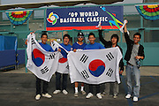 LOS ANGELES, CA - MARCH 21: Fans of Korea wave flags and cheer for their team as Korea gets ready to compete against Venezuela during game one of the semifinal round of the 2009 World Baseball Classic at Dodger Stadium in Los Angeles, California on Saturday March 21, 2009. Korea defeated Venezuela 10-2. (Photo by Paul Spinelli/WBCI/MLB Photos)