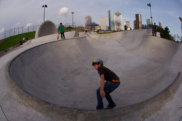 young boy skateboarding at the Lee & Jo Jamail skatepark on the outskirts of downtown Houston