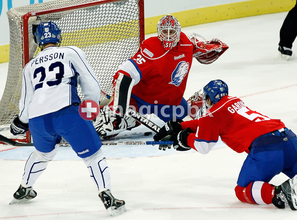 Linkoepings HC forward Niklas Persson, left, scores against ZSC Lions goaltender Ari Sulander, center, while forward Ryan Gardner, right, during the ice hockey Campions League preliminary round group D game 20 between ZSC Lions of Switzerland and Linkoepings HC of Sweden held at the Hallenstadion in Zurich, Switzerland, Wednesday, November 19, 2008. (Photo by Patrick B. Kraemer / MAGICPBK)