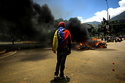 July 30, 2017 - Caracas, Capital District, Venezuela - The Venezuelan opposition went to protest against the National Constituent Assembly (ANC) in La Plaza Altamira, in Caracas, Venezuela. This July 30, 2017. Around 4 moto bikes were burned in Plaza Altamira by an explosion of an artifact that exploded as the National Bolivarian Police (PNB) passed. Two agents were injured. (Credit Image: © Adrian Manzol via ZUMA Wire)