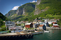 Colorful photo of a small seaside town in the fjords of Norway, at Aurland