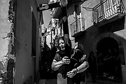 """27 August 2017, Guardia Sanframondi, Southern Italy - """"Riti Settennali di Penitenza"""" is a traditional penitential rite taking place in the southern Italian town of Guardia Sanframondi every seven years. Everything happens since centuries and it is the largest self-punishment rite in the Western world. A series of processions starts in the week following the Assumption. The """"Mysteries"""", honors the discovery of a Mary and Child statue in a field hundreds of years ago, through a series of parades of people dressed as characters from the Bible or recent religious episodes. The participants join together on the following Sunday for the main procession, when the flagellation occurs. More than thousand men and women dressed in white and wearing hoods to hide their face. Some participants, """"flagellanti"""", strike their backs with small strips of metal chained together. Others, """"battenti"""" tap against their bare chests with disks of cork pierced by needles, creating red patches of raw flesh, and sometimes blood. Attendants pour white wine on the cork as disinfectant, and to keep the wounds open. All this for for reconcile their sin with God. This year about a thousand people between """"battenti"""" and """"flagellanti"""" participated to the final procession on Sunday, the most striking and crowded. Many of these, (over the forty percent) they were women.The ritual has drawn some criticism over the years. The Italian journalist and writer Roberto Saviano, said that members of the local crime organization, the Camorra, use the anonymity as a way of seeking secret redemption. The next one will be in 2024."""