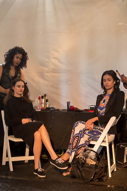 Models get their hair and makeup done backstage for the Michael Costello fashion show at Fashion Week El Paseo in Palm Desert, California. Photos by Tiffany L. Clark