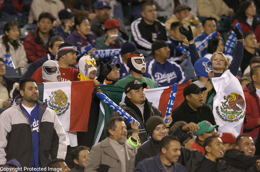 Team Mexico fans hold up the country's flag during the game against Team Korea in Round 2 action at Angel Stadium of Anaheim.