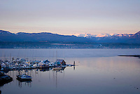 The Comox Marina, Comox Bay and the ever-present Comox Glacier illustrate why the Comox Valley is such a popular place to live and visit.  Comox Valley, Vancouver Island, British Columbia, Canada.