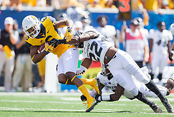 Sep 3, 2016; Morgantown, WV, USA; West Virginia Mountaineers wide receiver Daikiel Shorts (6) makes a catch and is tackled by Missouri Tigers defensive back Anthony Sherrils (22) during the first quarter at Milan Puskar Stadium. Mandatory Credit: Ben Queen-USA TODAY Sports