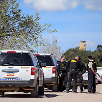040115       Cable Hoover<br /> <br /> McKinley County Sheriff's officers gather on Cascade Street in Gamerco during a drug raid Wednesday.