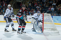 KELOWNA, CANADA - SEPTEMBER 28:  Ryan Olsen #27 of the Kelowna Rockets looks for the pass while checked by Jordan Fransoo #4 and Coleman Vollrath #35 of the Victoria Royals  at the Kelowna Rockets on September 28, 2013 at Prospera Place in Kelowna, British Columbia, Canada (Photo by Marissa Baecker/Shoot the Breeze) *** Local Caption ***