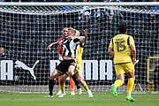 Notts County forward Jonathan Stead (30) is held by Morecambe defender Dean Winnard (6)  during the EFL Sky Bet League 2 match between Notts County and Morecambe at Meadow Lane, Nottingham, England on 9 September 2017. Photo by Simon Davies.