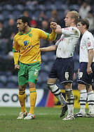 Preston - Saturday February 14th, 2009: Andy Davies of Preston North End and Jon Otsemobor of Norwich City tussle during the Coca Cola Championship match at Deepdale, Preston. (Pic by Michael Sedgwick/Focus Images)