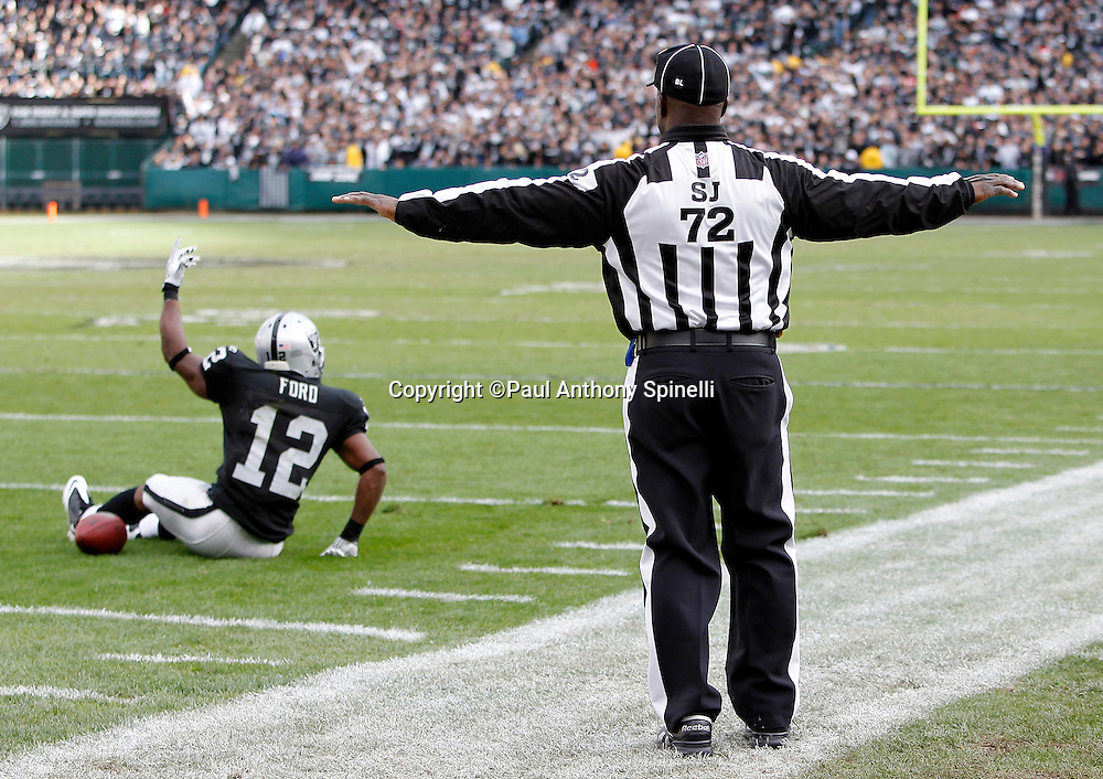 NFL side judge Michael Banks (72) calls no penalty despite the appeal for a pass interference penalty by Oakland Raiders wide receiver Jacoby Ford (12) during the NFL week 16 football game against the Indianapolis Colts on Sunday, December 26, 2010 in Oakland, California. The Colts won the game 31-26. (©Paul Anthony Spinelli)