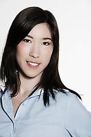 studio shot portrait of a beautiful southeast asian young woman smiling