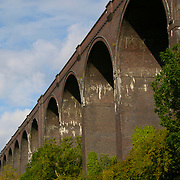 The arches of the Conisbrough Railway Viaduct Bridge on a bright sunny day in South Yorkshire, England