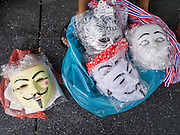 "09 JUNE 2013 - BANGKOK, THAILAND:  Guy Fawkes masks for in front of Central World Mall before an anti-government protest. The White Mask protesters wear the Guy Fawkes mask popularized by the movie ""V for Vendetta"" and the protest groups Anonymous and Occupy. Several hundred members of the White Mask movement gathered on the plaza in front of Central World, a large shopping complex at the Ratchaprasong Intersection in Bangkok, to protest against the government of Thai Prime Minister Yingluck Shinawatra. They say that her government is corrupt and is a ""puppet"" of ousted (and exiled) former PM Thaksin Shinawatra. Thaksin is Yingluck's brother. She was elected in 2011 when her brother endorsed her.    PHOTO BY JACK KURTZ"