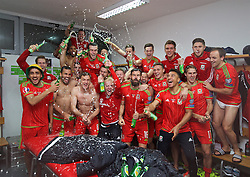 ZENICA, BOSNIA & HERZEGOVINA - Saturday, October 10, 2015: Wales players celebrate in the dressing room after qualifying for the finals despite a 2-0 defeat to Bosnia and Herzegovina during the UEFA Euro 2016 qualifying match at Stadion Bilino Polje. (Pic by David Rawcliffe/Propaganda)