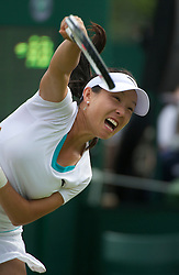 LONDON, ENGLAND - Wednesday, June 22, 2011: Jie Zheng (CHN) in action during day three of the Wimbledon Lawn Tennis Championships at the All England Lawn Tennis and Croquet Club. (Pic by David Rawcliffe/Propaganda)