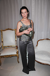 OLIVIA WILLIAMS at a party to celebrate Lancome's 10th anniversary of sponsorship of the BAFTA's in association with Harper's Bazaar magazine held at St.Martin's Lane Hotel, London on 19th February 2010.