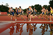 May 2, 2019; Stanford, CA, USA; Runners are reflected in the water jump in the steeplechase during the 24th Payton Jordan Invitational at Cobb Track & Angell Field.