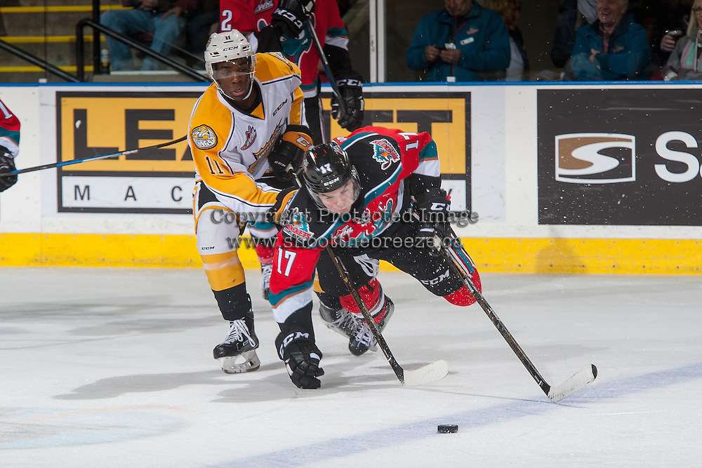 KELOWNA, CANADA - DECEMBER 3: Rodney Southam #17 of the Kelowna Rockets gets tripped up by Caiden Daley #11 of the Brandon Wheat Kings during second period on December 3, 2016 at Prospera Place in Kelowna, British Columbia, Canada.  (Photo by Marissa Baecker/Shoot the Breeze)  *** Local Caption ***