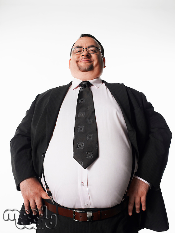 Overweight smiling businessman with hands on hips