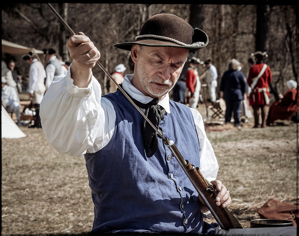 Militiaman cleans his musket at 2017 Battle of Guilford Courthouse Reenactment.