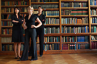 Three lawyers in library standing