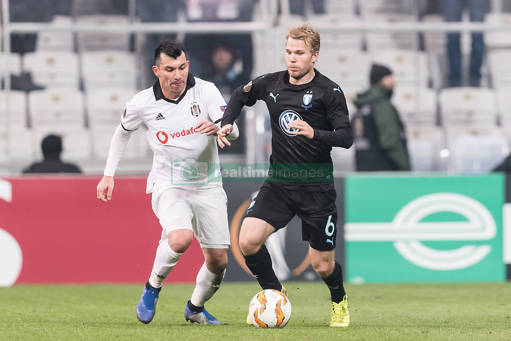 (L-R) Gary Alexis Medel Soto of Besiktas JK  , Oscar Lewicki of Malmo FF during the UEFA Europa League group I match between between Besiktas AS and Malmo FF at the Besiktas Park on December 13, 2018 in Istanbul, Turkey