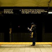 A woman waits for the train in the Port Authority subway station in New York, February 19, 2010.
