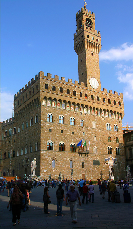 The Palazzo Vecchio is the town hall of Florence, Italy. Romanesque, crenulated fortress-palace overlooking the Piazza della Signoria with its copy of Michelangelo's David statue as well the gallery of statues in the adjacent Loggia dei Lanzi