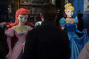 Girl Disney characters and a male shopper admirer in Covent Garden, central London.