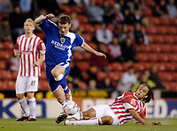 Photo: Glyn Thomas.<br />Stoke City v Cardiff City. Coca Cola Championship.<br />27/09/2005.<br /> Stoke's Darel Russell (R) slides in to tackle Cardiff's Jason Koumas.
