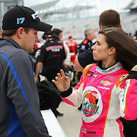 Danica Patrick, driver of the Florida Lottery Chevrolet, speaks to her boyfriend Ricky Stenhouse Jr. after the qualifying practice session of the NASCAR Nationwide Drive4COPD 300 was cancelled, at Daytona International Speedway on Friday, February 21, 2014 in Daytona Beach, Florida.  (AP Photo/Alex Menendez)