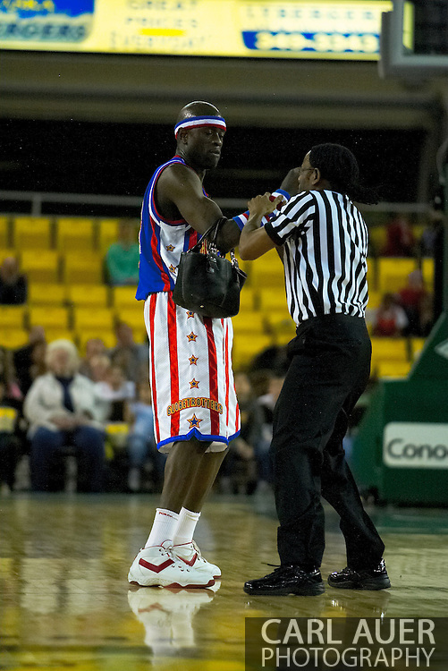 "05 May 2006: Kevin ""Special K"" Daley struggles with a referee over a fans stolen purse during the Harlem Globetrotters vs the New York Nationals at the Sulivan Arena in Anchorage Alaska during their 80th Anniversary World Tour."
