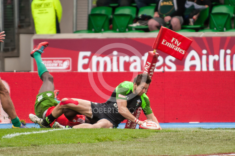 Wales' Jason Harries dives over for a try against Portugal. Action from the IRB Emirates Airline Glasgow 7s at Scotstoun in Glasgow. 4 May 2014. (c) Paul J Roberts / Sportpix.org.uk