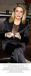 Actress CATHERINE DENEUVE,  at a party in London on 27th November 2002.<br />PFR  78