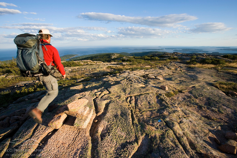 A hiker on Cadillac Mountain in Maine's Acadia National Park.  South Ridge Trail. MR