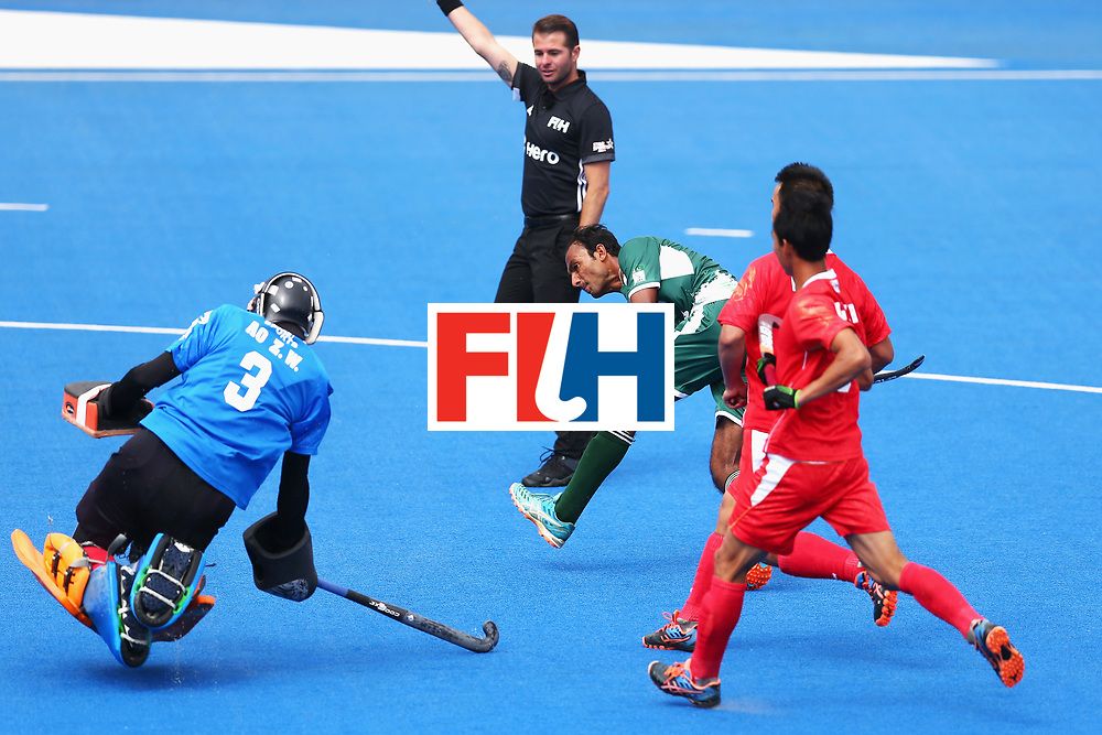 LONDON, ENGLAND - JUNE 25:  Muhammad Umar Bhutta of Pakistan scores his sides first goal past Zhiwei Ao of China during the 7th/8th place match between Pakistan and China on day nine of the Hero Hockey World League Semi-Final at Lee Valley Hockey and Tennis Centre on June 25, 2017 in London, England.  (Photo by Steve Bardens/Getty Images)